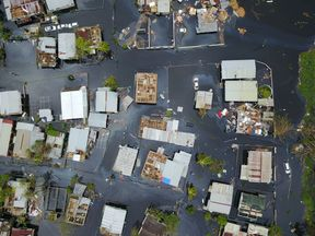 The neighbourhood of Juana Matos is completely flooded after Hurricane Maria