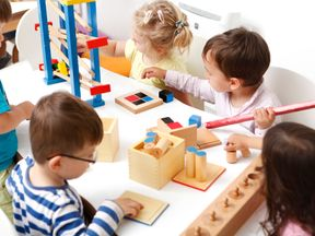 Children learning to play while at nursery school. File pic