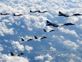 U.S. Air Force B-1B Lancer bombers flying with F-35B fighter jets