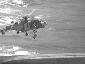 A Royal Navy helicopter hoisted the woman and her children to safety