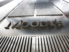 A Moody's sign is displayed on 7 World Trade Center, the company's corporate headquarters in New York, February 6, 2013