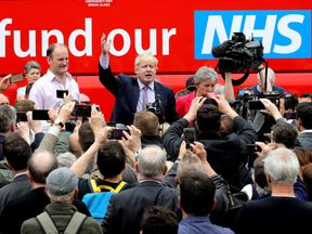STAFFORD, ENGLAND - MAY 17: Boris Johnson MP, Labour MP Gisela Stuart and UKIP MP Douglas Carswell address the people of Stafford in Market Square during the Vote Leave, Brexit Battle Bus tour on May 17, 20016 in Stafford, England. Boris Johnson and the Vote Leave campaign are touring the UK in their Brexit Battle Bus. The campaign is hoping to persuade voters to back leaving the European Union in the Referendum on the 23rd June 2016. (Photo by Christopher Furlong/Getty Images)