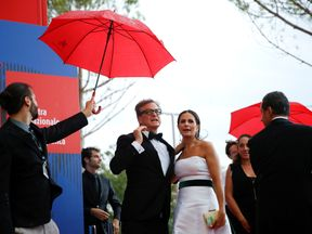 Colin Firth and his wife Livia Giuggioli arrive for the Franca Sozzani Award ceremony