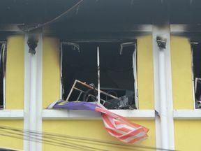 Burnt windows of the Darul Quran Ittifaqiyah religious school in Kuala Lumpur