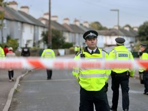 Police officers taking part in an operation in Cavendish Road, Sunbury-on-Thames, Surrey, as part of the investigation into the Parsons Green bombing.
