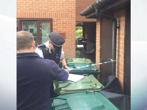 Officers searching a property in west London
