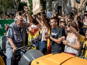Students cheer and shout as they join a pro-independence farmers' protest