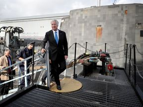 Defence Secretary Sir Michael walks alongside the Vanguard-class nuclear deterrent submarine HMS Vengeance