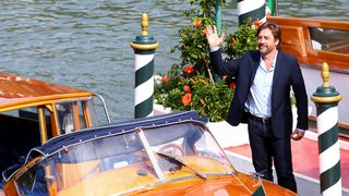 """Actor Javier Bardem waves as he arrives for the movie """"Mother! """""""