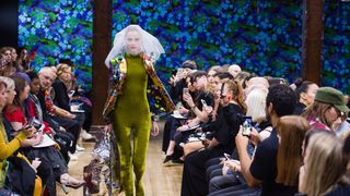 A model in Liberty print walks the runway during the Richard Quinn SS18 show at Liberty London