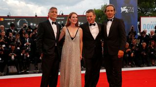 """Actor and director George Clooney, actors Julianne Moore, Matt Damon and film composer Alexandre Desplat during a red carpet event for the movie """"Suburbicon"""""""