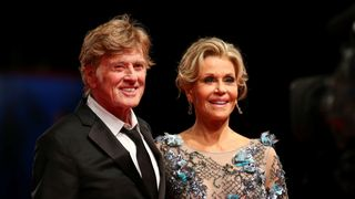 Robert Redford  and Jane Fonda during a red carpet to receive a Golden Lion award for lifetime achievement
