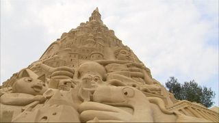 An international team of sand artists have built the world's tallest sandcastle in Germany