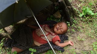 A Rohingya Muslim child sleeps after crossing the border from Myanmar, near the Bangladeshi town of Teknaf