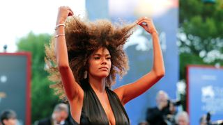 """Tina Kunakey poses as she arrives during a red carpet event for the movie """"Mother!"""""""