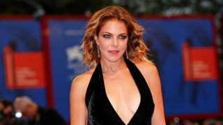 """Actress Claudia Gerini poses at the red carpet for the movie """"Ammore e malavita"""""""