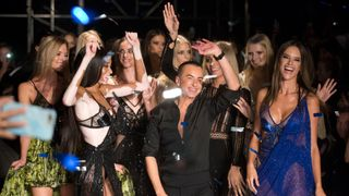Designer Julien Macdonald greets the audience after his show