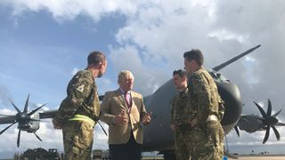 Boris Johnson speaks to an RAF crew on his visit to the Caribbean