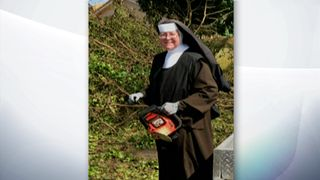 Sister Margaret Ann slices up fallen trees with a chainsaw after Hurricane Irma