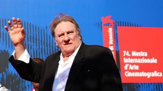 """Gerard Depardieu waves as he arrives during a red carpet event for the movie """"Novecento- Atto Primo"""""""