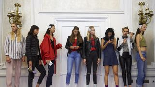 Models wait backstage ahead of the catwalk show by Peter Pilotto