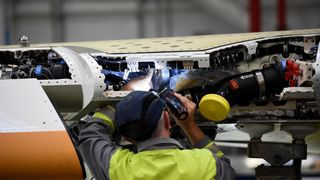 A man works on C Series aeroplane wing in the Bombardier factory in Belfast, Northern Ireland September 26, 2017