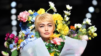 Model Gigi Hadid presents a creation for fashion house Moschino during the Women's Spring/Summer 2018 fashion shows in Milan