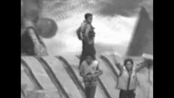 The three were stranded on the upturned vessel's hull