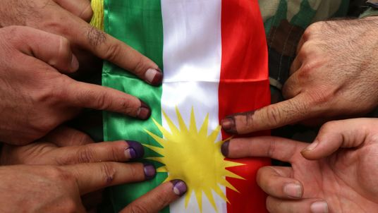 Kurds brush off threats, cast vote in referendum