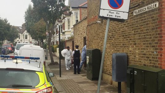 The body was found in Pulborough Road in the Southfields area of southwest London
