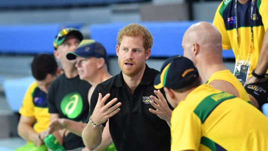 Prince Harry speaks to athletes during a training session in Toronto