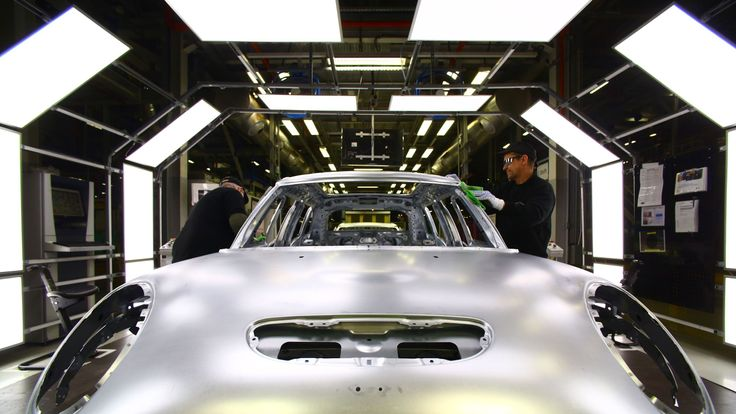 A Mini in the early stages of production receives its final inspection before being painted