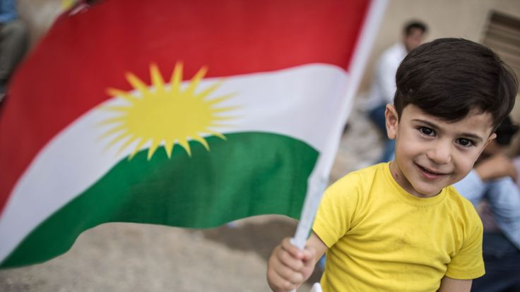 An Iraqi Kurdish boy holds a Kurdish flag at a school in Arbil which is being used as a polling station as voters cast their ballots in the Kurdish independence referendum on September 25, 2017. Iraqi Kurds voted in an independence referendum, defying warnings from Baghdad and their neighbours in a historic step towards a national dream