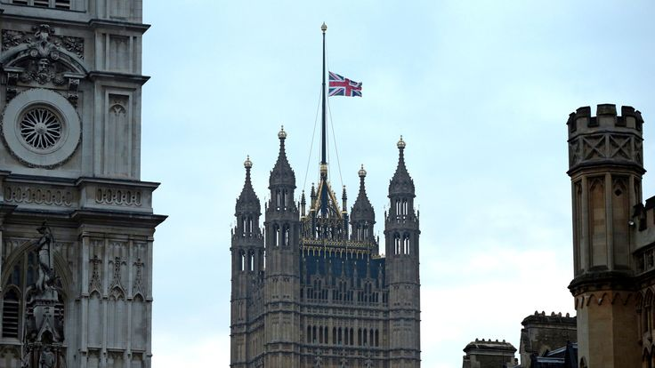 The flag above the Houses of Parliament at half mast after a terrorist attack where police officer Keith Palmer and three members of the public died