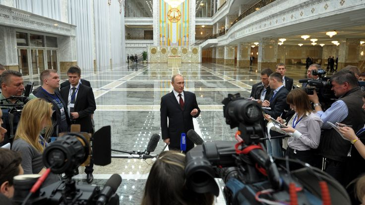 Russia's President Vladimir Putin speaks to journalists in the Belarus capital Minsk, on April 29, 2014, after attending a session of the Supreme Eurasian Economic Council . Putin warned yesterday that new EU and US sanctions could impact the work of Western energy firms in Russia and denied there were any Kremlin forces in eastern Ukraine