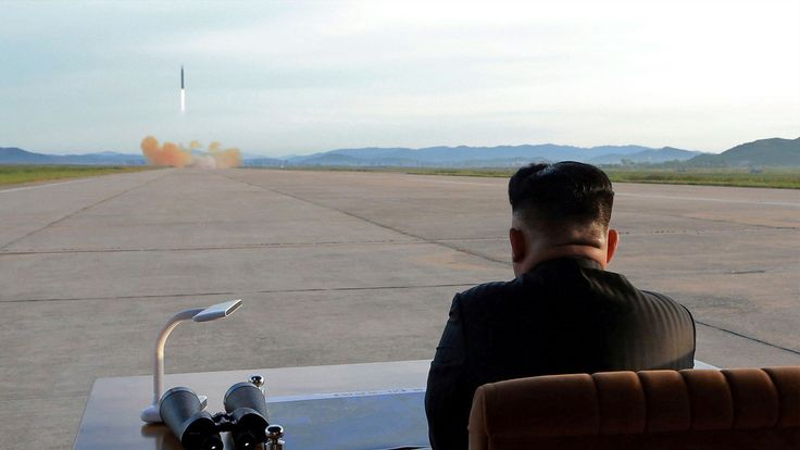 Kim Jong Un watches the launch of a Hwasong-12 missile