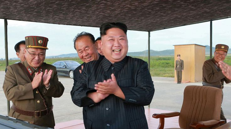 North Korean leader Kim Jong Un guides the launch of a Hwasong-12 missile