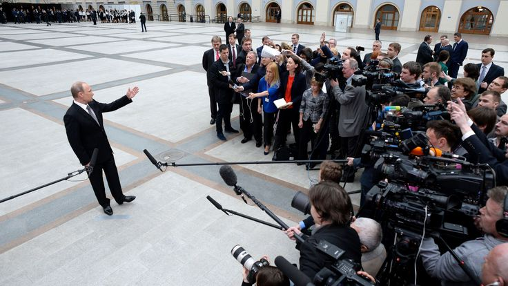 Russian President Vladimir Putin speaks with journalists shortly after his annual televised phone-in with the nation in central Moscow on April 16, 2015
