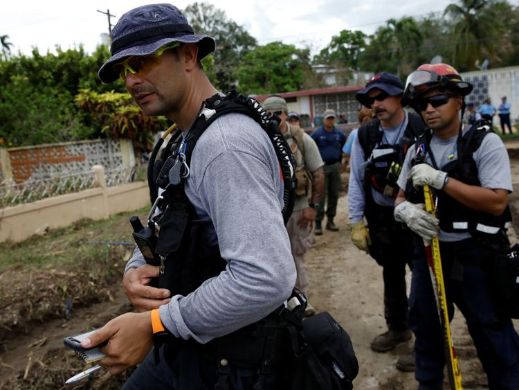 Members of the Federal Emergency Management Agency (FEMA) Urban Search and Rescue team conduct a search operation at an area hit by Hurricane Maria in Yauco, Puerto Rico, September 25, 2017