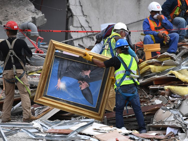 Recovery teams find a painting amid debris