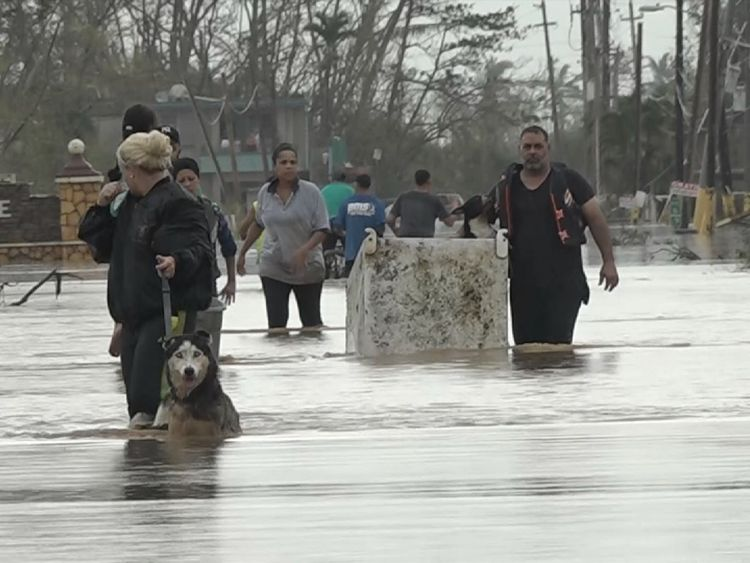 Army trucks have been helping people get out of submerged parts of Toa Baha