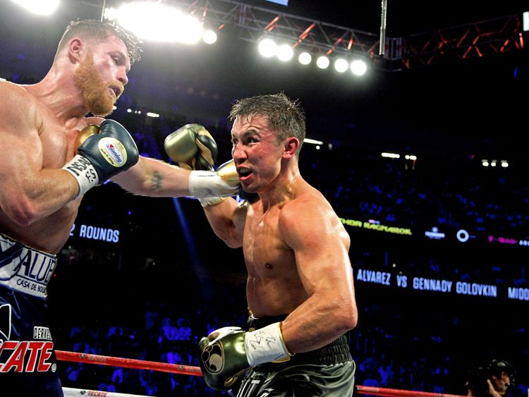 Canelo Alvarez (L) unleashes a left hook against Gennady Golovkin (R) during their WBC, WBA and IBF middleweight championship fight at the T-Mobile Arena on September 16, 2017 in Las Vegas, Nevada. Gennady Golovkin retained his three world middleweight titles, fighting to a draw with Mexican star Canelo Alvarez in a showdown for middleweight supremacy that lived up the hype. / AFP PHOTO / John GURZINSKI (Photo credit should read JOHN GURZINSKI/AFP/)