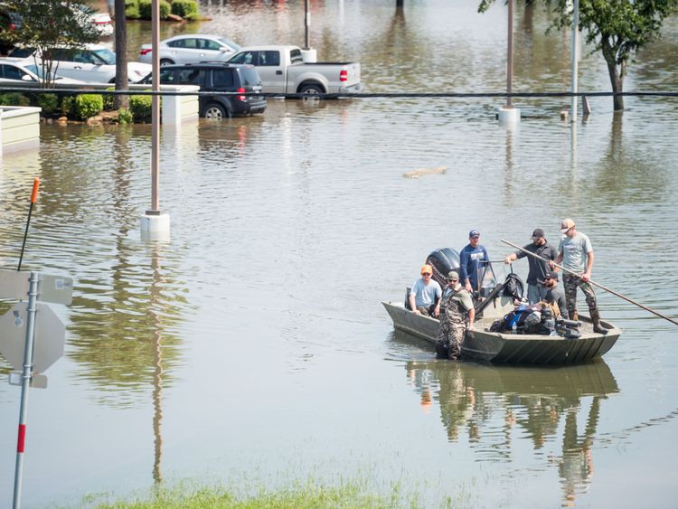 Rescue crews help Harvey flood victims