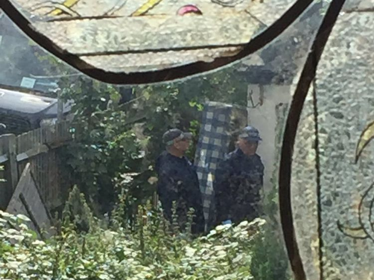 Police in the garden of a house in Thornton Heath