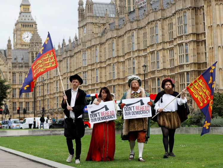 A man dressed as King Henry VIII protests outside the Houses of Parliament as MP's debate the European Union Withdrawal Bill