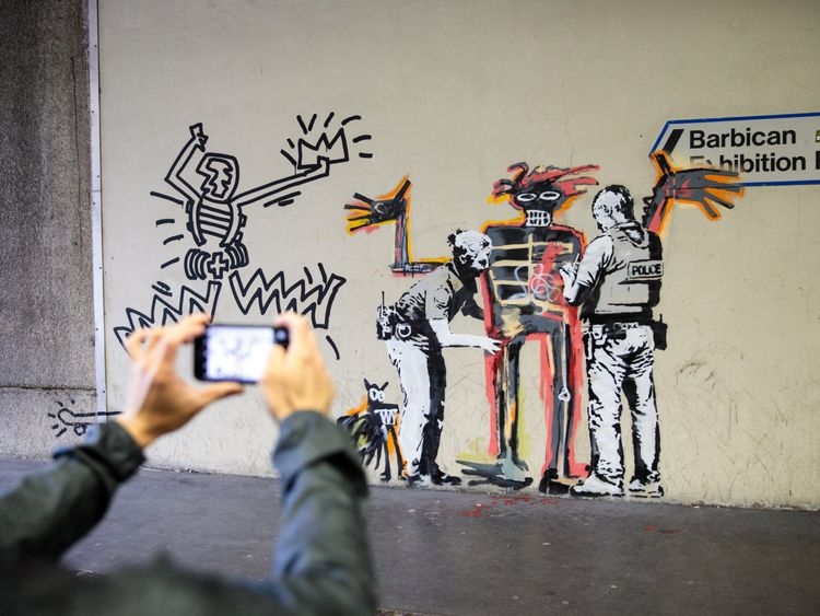 Banksy has appeared on the side of The Barbican as the Basquiat exhibition begins