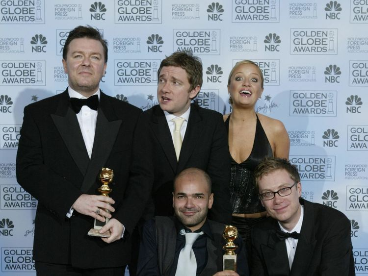 The cast of The Office pose with a Golden Globe after winning best TV comedy series in 2004