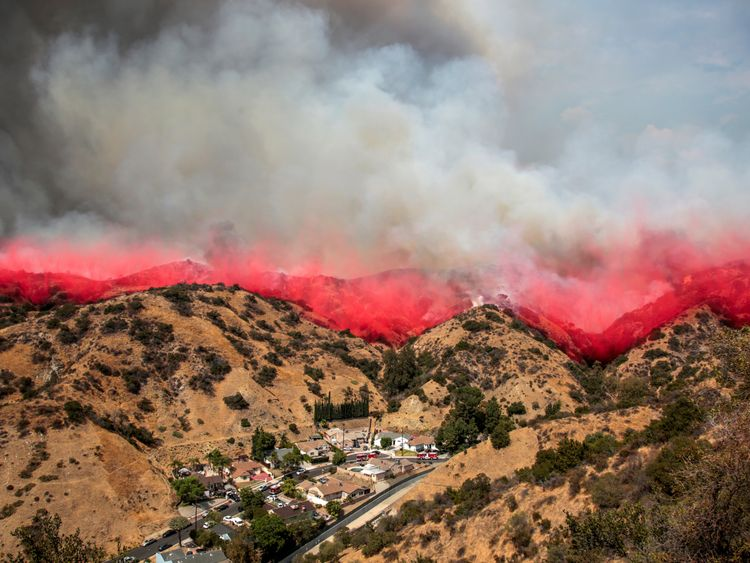 Flame retardant is dropped on the hills above Burbank