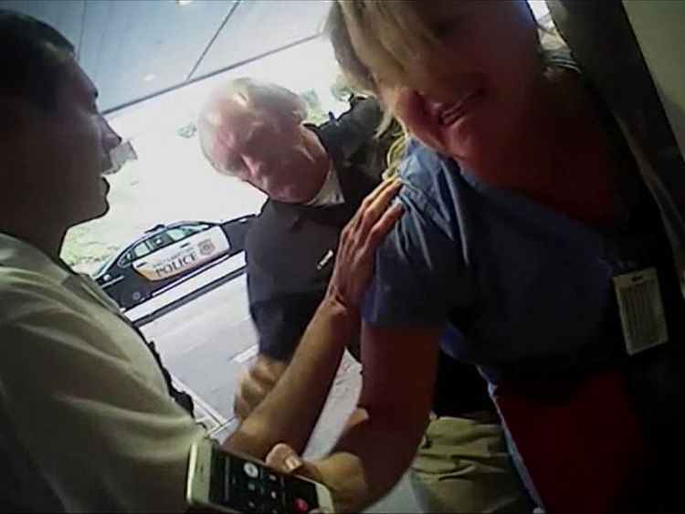 Salt Lake City nurse Alex Wubbels is handcuffed by police for refusing to take a blood sample from a patient