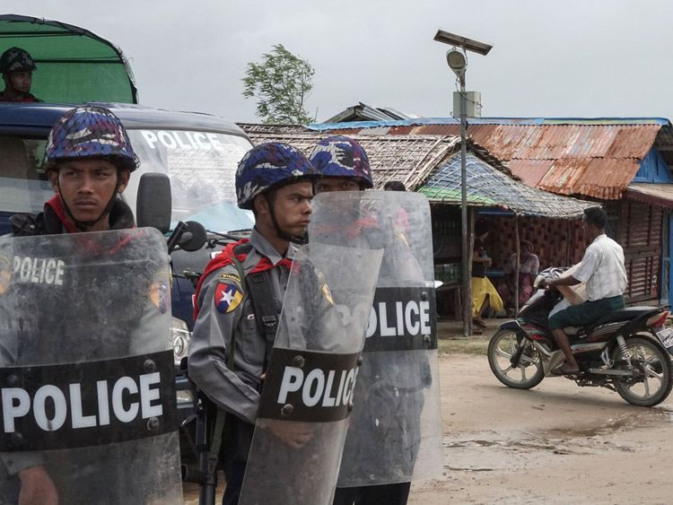 Myanmar police standing guard at an Internally Displaced Persons camp in Rakhine State